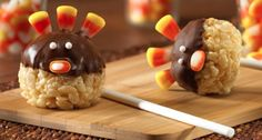 Rice Crispy Treat Turkey Pops...make rice crispy treats..mold into balls...insert lollipop stick in one end...let cool...when cool dip in melted chocolate and add candy corn...when cool add eyes.