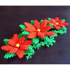 This unique custom poinsettia made from LEGO ® elements is just the thing to liven up your home for Christmas. Great as a table decoration or cake topper. This set comes with 1 large poinsettia flower x 8 Lego Christmas Tree, Christmas Wreaths, Christmas Crafts, Christmas Decorations, Christmas Ornaments, Lego Ornaments, Christmas Parties, Holiday Decor, Lego Disney