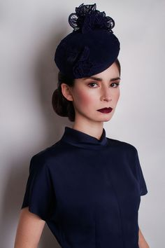 GUIPURE LACE DISC £295.00 Handcrafted in our London studio. Peachbloom felt cocktail hat with hand cut sculpted lace trim. Colour: Navy. Secured with a comb and elastic. 1 in stock. UK delivery 3-5 working days. Free UK delivery, includes Black & White striped hat box.
