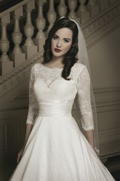 A gorgeous lace neckline with a pleated silk cummerbund -- ultra elegant!   @Justin Alexander   #Wedding Dresses   Style #8695
