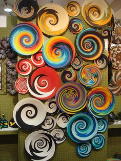 African plates covering wall. These could be remade a little different using glass frit in the kiln or even painting plain plate as a beautiful way to fill a wall