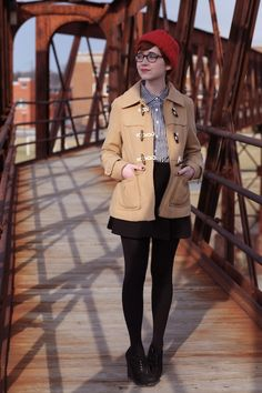 The Clothes Horse/red knit cap/gingham button up/brown toggle coat/black skater skirt/black opaque tights/oxford heels