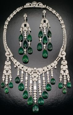 Emerald and diamond necklace - Designed by Ostertag; set with carved emeralds and diamonds in platinum; circa 1930. The longest dangle on the necklace and the earrings are each about 3 1/2 inches long. Photograph by Tino Hammid.