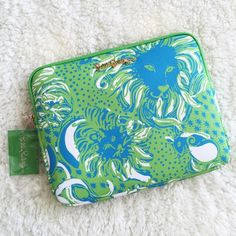 Lilly Pulitzer Tech Clutch NEW WITH TAGS! Print: Limeade Roar of the Jungle. Colors are very vibrant! This printed pebble PVC zip ipad clutch has a chic gold trimmings that dress it up for a night on the town as an oversized clutch, and it is perfectly fitted for your iPad 2 or 3. To make this clutch even better, there is a pocket for your phone and credit card slots inside to keep you perfectly organized! 11in wide x 8.25in high x 1in deep. Lilly Pulitzer Accessories Tablet Cases