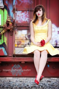 Senior back of old trailer. Love the dress next to rustic background.