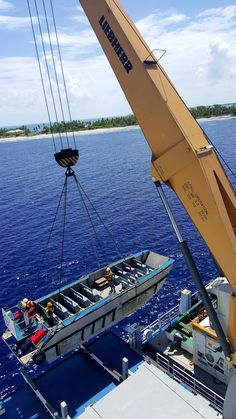 The crew lowering a tender boat into the South Pacific.  #Aranui #Marquesas #adventure