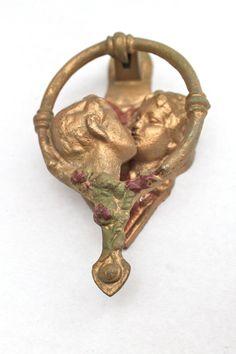 vintage gold kissing couple door knocker via Etsy