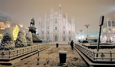 Snow covers the Piazza Duomo square in Milan, Italy