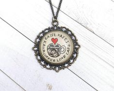Hand drawn pendant necklaces and handmade earrings. by EternalGirl