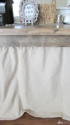 How to hide office clutter --Tutorial for making this French inspired curtain from Farmhouse Chic Blog.