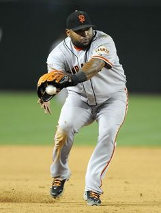 Pablo Sandoval #48 of the San Francisco Giants makes a backhanded play on a ground ball against the Arizona Diamondbacks at Chase Field on April 30, 2013 in Phoenix, Arizona.