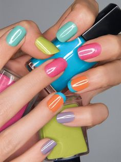 Pastel brights. Love the French tip on just the ring fingers.