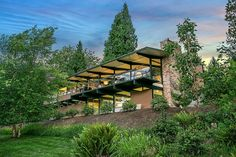 Spectacular Wendell Lovett-designed home in Hilltop, one of the Northwest's most sought-after collection of Mid-Century Modern masterpieces. Originally constructed in 1956, this architectural gem has been updated for the 21st century while remaining true to its original design with new windows, roof, waterproofing, drainage, and other features focused on livability and energy efficiency. Jetliner views on an acre in heaven, all just minutes from Downtown Bellevue.