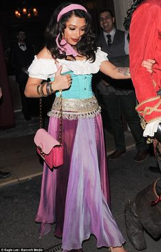 Purple power: Vanessa's hair was curled into loose waves as part of her costume as she clu...