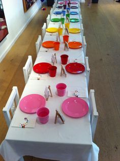 Rainbow party decorations & tableware - use different coloured plates/cups rather than striped to give the rainbow affect too.
