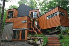 At even a long glance, it's hard to believe this house is made from shipping containers! Painted in a mid-century-modern-esque color palette and nestled in the woods of Quebec, it's an impressive sight. The housing is low-maintenance and low-cost, even when taking into account the cost of full construction and added insulation. Plus, you can feel great about recycling shipping containers that typically have a usage span of only 20 years.