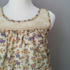 Lilly Lou floral and lace top Adorable little feminine top! Perfect condition -- no flaws!  Bundle for best deals!! Lots of items available starting at $5! Hundreds of items available for discounted bundles! You can get lots of items for a low price and one shipping fee! Lilly lou Tops