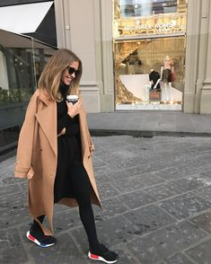 Irina Golomazdina. Street style. Total Black look. Adidas sneakers, Black dress. Camel trench.