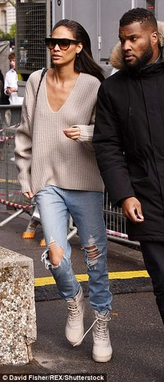 Running off: Joan Smalls went for the most casual look out of the model troupe as she team...