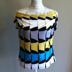 WORTHINGTON STRETCH TOP Black, turquoise, mustard and white top. Neckline goes from shoulder to shoulder but doesn't go off the shoulder. 95% polyester 5% spandex  new with tags. Size large Tops Tunics
