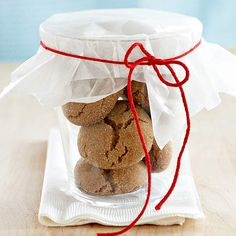 Covered Glass Tumbler ~~ Package our Cardamom Snaps in a glass tumbler, seal with waxed paper, and tie with a simple bow for a festive cookie gift you can make in minutes. Find a holiday decorated glass to make this gift even more festive.