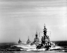 US battle line steaming into position to bombard Kamaishi steelworks on  mainland Japan. Photo taken from USS South Dakota (BB-57). Battleships USS Indiana (BB-58), USS Massachusetts (BB-59) and heavy cruisers USS Chicago (CA-136) and USS Quincy (CA-71) follow behind, 14 July 1945.