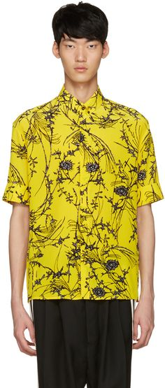 Short sleeve woven silk shirt in yellow. Graphic pattern printed in black and white throughout. Button-down spread collar. Concealed button closure at front. Rolled cuffs. Tonal stitching.
