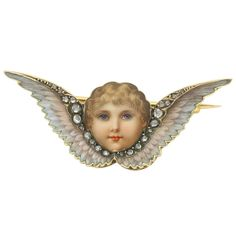 1885 Victorian Enamel Rose Diamond Gold Winged Cherub Brooch (Wish they came in every color-skin, eyes, hair.) | From a unique collection of vintage brooches at https://www.1stdibs.com/jewelry/brooches/brooches/