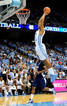 J.P. Tokoto #25 of the North Carolina Tar Heels dunks against the East Tennessee State Buccaneers during play at Dean Smith Center on December 8, 2012 in Chapel Hill, North Carolina.