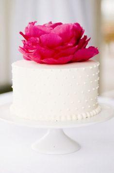White polka dot cake with bright flower