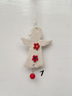 White Ceramic Angel Empowered with Reiki Energy. Gives as a gift to teachers,friends, babies,hang in your home to call in the Angels . by DelabudCreations on Etsy Ceramic Angels, Reiki Energy, White Ceramics, Babies, Christmas Ornaments, Friends, Holiday Decor, Unique Jewelry, Handmade Gifts