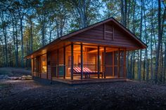 So awesome! How a talented architect makes an RV look like a charming cabin in the woods!