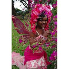 Nompumelelo the Abatwa Zulu Fairy photographed by Chris Gates! This was shot in South Africa at the Durban Botanical Gardens. She is wearing the Flora wings in custom painted fuchsia and pink tones, as well as a gorgeous floral head dress from @missgdesi | Flickr - Photo Sharing!