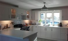 So pleased with my new kitchen!! Cashmere shaker cupboards and blue Rangemaster really looks smart together.