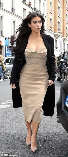 The hard work has paid off: Kim Kardashian looked absolutely stunning in her strapless midi dress