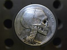Hobo Skull Nickels are re-engraved/re-carved old buffalo nickels that were minted in the USA from The tradition started during the Great Depression with the traveling Hobos who would alter the face of the nickel and then trade them for necessities. Memento Mori, Post Mortem, Hobo Nickel, Great Depression, Old Money, Old Coins, Skull And Bones, Skull Art, Macabre