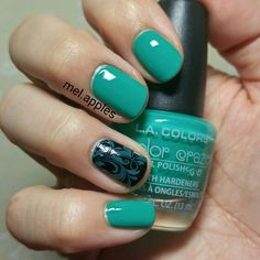 L.A. Colors Color Craze Jaded CNP685. Sea green cream. Three coats shown to smooth steaks, but full coverage in two. Stamped over black on ring finger.
