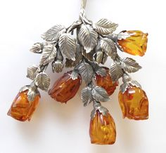 "AMBER LOVE . . . Sterling and carved amber rose ""bouquet"" pendant"