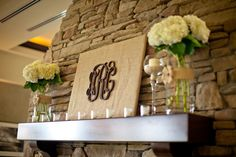The monograms on burlap here - you could do this with burlap-wrapped tagboard and wooden letters, painted yellow and navy.