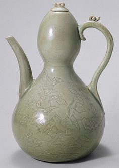 Wine ewer, Goryeo dynasty (918–1392), early 12th century  Korea  Stoneware with incised and carved decoration of geese, waterbirds, and reeds under celadon glaze