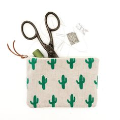 This is a Linen pouch printed with my Cactus design. It is screen printed with green water based ink & sewn by hand. Made with a high quality natural