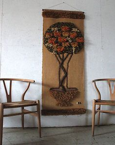 Wegner chairs and fabric wall hanging. Pinned by a Taste Setter: http://www.thetastesetters.com