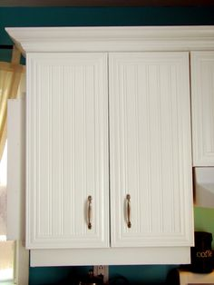 Beadboard and molding on cabinet doors...we could actually afford this!
