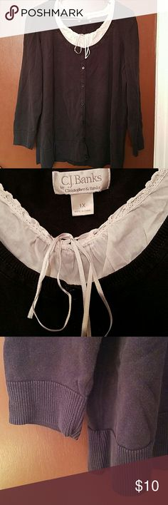 C.J. Banks Long-Sleeved Attached Two-Piece Sweater C.J.Banks long-sleeved sweater. 1X. White portion is attached to the inside of black sweater. Decorative front buttons. Good conditions. C.J. Banks Sweaters Crew & Scoop Necks