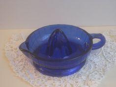 Vintage Cobalt Blue Depression Glass Juicer Reamer Bowl. $18.00, via Etsy.