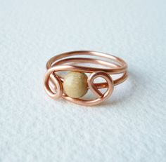Copper Wire Ring with one light wooden pearl - several photos of wire rings $10-$20