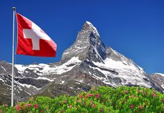Photo about Beautiful mountain Matterhorn with Swiss flag - Swiss Alps. Image of scenery, swiss, rocky - 17415395 Zermatt, Swiss Flag, Eastern Countries, St Moritz, Seen, Hotel Reservations, Christmas Vacation, Ski Vacation, Vacation Spots