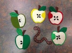"Apples by Busy Crafting Mommy; Five Little Apples  (to the tune of Teasing Mr.  Crocodile)    Five little apples hanging in a tree (hold up 5 fingers)  Teasing Mr. Slinky Worm ""you can't eat me!""  (wiggle pointer finger to be worm)  Along comes Mr. Slinky Worm quiet as can be…  And… CRUNCH! (clap hands)    Repeat with 4, 3, 2, 1, little apples.  No more apples hanging from the tree!"