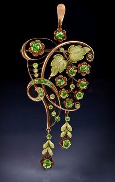 An Art Nouveau Demantoid Garnet and Two-Color Gold Pendant / Brooch. Made in Moscow between 1908 and The pink gold pendant / brooch is designed as a stylized grapevine with chased green gold leaves. Bijoux Art Nouveau, Art Nouveau Jewelry, Jewelry Art, Antique Jewelry, Jewelry Gifts, Vintage Jewelry, Fine Jewelry, Jewelry Design, Gold Jewelry