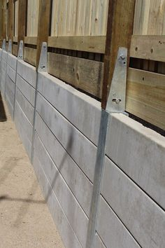 Pioneer Smooth Grey Concrete Sleeper Retaining Wall with Steel Fence Bracket sys. Concrete Sleeper Retaining Walls, Retaining Wall Fence, Concrete Sleepers, Backyard Retaining Walls, Building A Retaining Wall, Gabion Wall, Sloped Backyard, Backyard Fences, Cinderblock Fence
